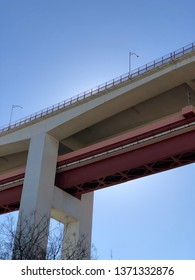 Lisbon / Portugal - March 19 2019: Low angle view of road bridge against clear blue sky in Lisbon, Portugal