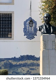 Lisbon / Portugal - March 19 2019: Statue in front of tile work on wall with hanging lamp in Lisbon, Portugal