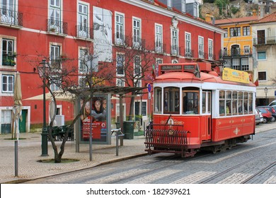 LISBON, PORTUGAL - MARCH 22, 2013: Vintage, orange streetcar or tram, a mode of public transportation on the hills of Alfama in Lisbon, Portugal, Europe on March 22, 2013