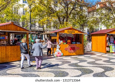 Lisbon, Portugal - March 27, 2018: Rossio square with spring Easter market and people