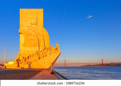 Lisbon, Portugal - March 29, 2017: Monument to the Discoveries or Padrao dos Descobrimentos on the bank of the Tagus River and the 25th of April Bridge at scenic sunset, Lisbon, Portugal