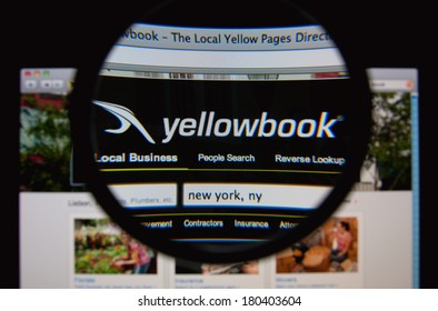 LISBON, PORTUGAL - MARCH 7, 2014: Photo of Yellowbook homepage on a monitor screen through a magnifying glass.