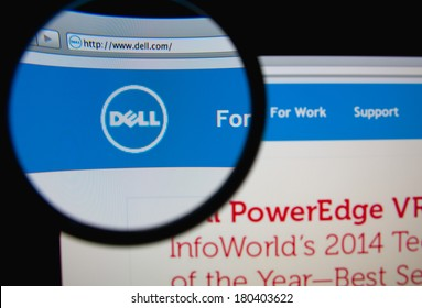LISBON, PORTUGAL - MARCH 7, 2014: Photo of Dell homepage on a monitor screen through a magnifying glass.