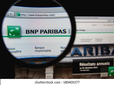 LISBON, PORTUGAL - MARCH 7, 2014: Photo of BNP Paribas homepage on a monitor screen through a magnifying glass. BNP Paribas is a French bank and financial services company.