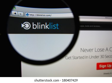 LISBON, PORTUGAL - MARCH 7, 2014: Photo of Blinklist homepage on a monitor screen through a magnifying glass.