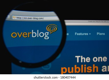 LISBON, PORTUGAL - MARCH 7, 2014: Photo of OverBlog homepage on a monitor screen through a magnifying glass.