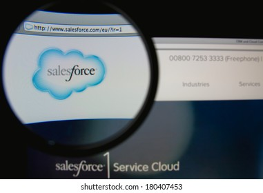 LISBON, PORTUGAL - MARCH 7, 2014: Photo of Salesforce.com homepage on a monitor screen through a magnifying glass. Salesforce.com is a global cloud computing company .