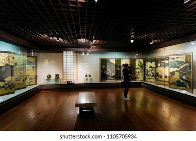 Lisbon, Portugal - May 04, 2018:A female visitor taking a picture at  Exhibition at the National Museum Of Ancient Art, Lisbon, Portugal.