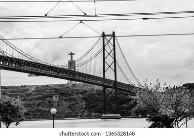 LISBON, PORTUGAL - MAY 07, 2008: View of 25 April Bridge on River Tagus and Christ the King monument in Lisbon, Portugal on May 07, 2008.