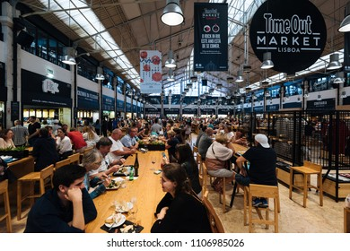 Lisbon, Portugal - May 07, 2018:  The busy food court of the Time Out food market in the Mercado da Riberia, Lisbon.