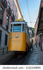 Lisbon, Portugal - May 11, 2010: People entering the Gloria Funicular (Elevador da Gloria) in the city of Lisbon, Portugal. Gloria Funicular connects the Pombaline downtown with Bairro Alto