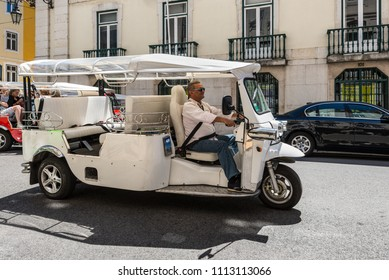 Lisbon, Portugal - May 19, 2017: Tuk Tuk Taxi on the street in Lisbon. Portugal. Tuk-tuk in Lisbon is one of the main medium of transportation for tourists to get around the city.