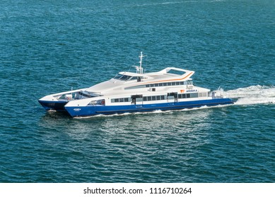 Lisbon, Portugal - May 19, 2017: High speed Passenger catamaran ferry Aroiera goes in the Tagus River, Lisbon, Portugal.