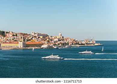 Lisbon, Portugal - May 19, 2017: View of Lisbon city with old architecture from cruise ship, Portugal. Saint Vicente de Fora Monastery and National Pantheon are located on a hill.