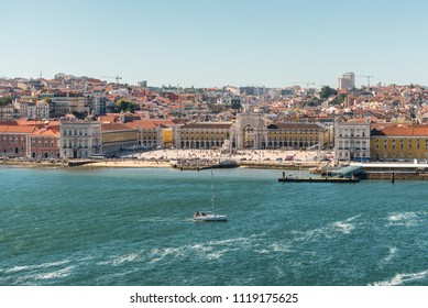 Lisbon, Portugal - May 19, 2017: Commerce square (Praca do comercio) in Lisbon viewed from Tajo river, Portugal. The Square was destoryed by the 1755 Lisbon Earthquake and then it was reconstructed.