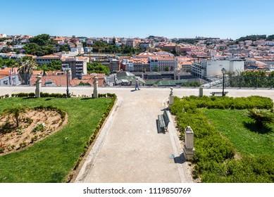 Lisbon, Portugal - May 19, 2017: View over the center of Lisbon from the viewpoint called: Miradouro de Sao Pedro de Alcantara.