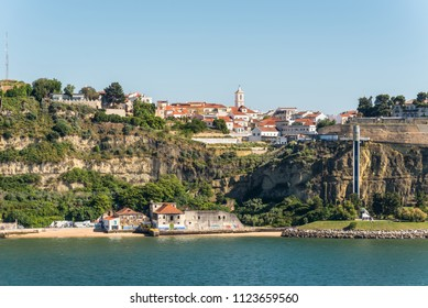 Lisbon, Portugal - May 19, 2017: Waterfront view of the Small Town Cacilhas in District Almada near Lisbon. Cacilhas is situated on the south bank of the river Tagus facing the city of Lisbon.