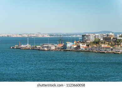 Lisbon, Portugal - May 19, 2017: Waterfront view of the Small Town Cacilhas in District Almada near Lisbon in Portugal. Cacilhas is situated on the south bank of the river Tagus facing the Lisbon.