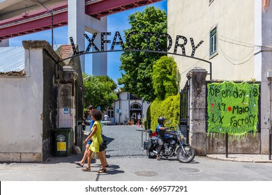 Lisbon, Portugal - May 20, 2917: Entrance gate to the LX Factory complex located under the Ponte 25 de Abril bridge in Lisbon
