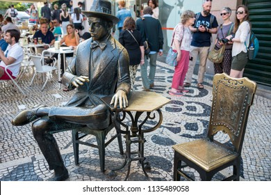 Lisbon, Portugal - may 22, 2017: Sculpture by the poet Fernando Pessoa in front of the Brasileira cafe, in the Chiado neighborhood, in the tourist center of the city