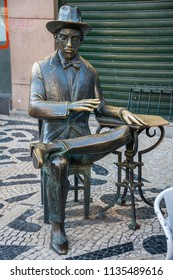 Lisbon, Portugal - may 22, 2017: Sculpture by the poet Fernando Pessoa on a street in the Chiado district, in the tourist center of the city