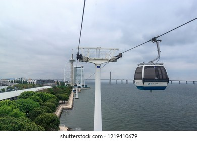 Lisbon, Portugal - May 22. 2018 Telecabine Lisboa at Park of Nations  (Parque das Nacoes). Cable car in the modern district of Lisbon over the Tagus river. Vasco da Gama tower and bridge.