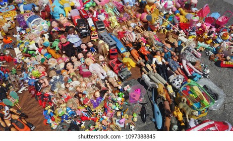 Lisbon, Portugal, May 23, 2018. Feira da Ladra. Street flea market of old things and antiques. Stands with ceramics and household items, Portuguese tiles, toys and decorative objects.