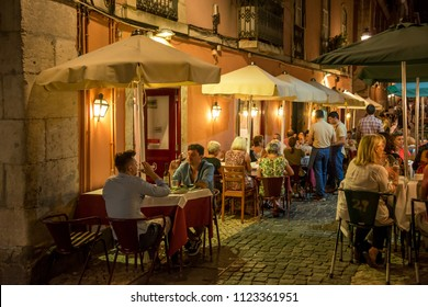 Lisbon, Portugal - may 24, 2017: Nightlife in the terraces of bars and restaurants in the Chiado neighborhood, in the upper area of the city