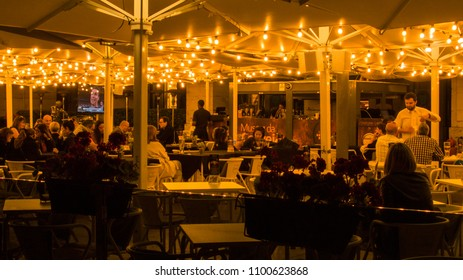 Lisbon / Portugal - May 26 2018: Restaurante in the evening time on the Commerce square in Lisbon, Portugal.