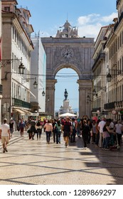Lisbon, Portugal - May 6, 2017: Rua Augusta, main pedestrian and shopping street. The arch of Augusta Rua, the triumphal arch at the end of the street. People walking in the street.