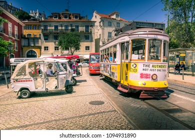 Lisbon, Portugal, May 6, 2018: Passengers onboard the famous Tram at the Castelo stop.