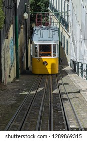 Lisbon, Portugal - May 7, 2017: Ascensor do Lavra Funicular or Elevador do Lavra going uphill in Calçada do Lavra street. Tradition yellow tram/funicular railway line in Lisbon.