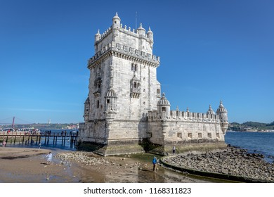 Lisbon, Portugal - May 8th 2018 - Tourists and locals enjoying a blue sky afternoon in the Belem Tower, heritage site of Unesco in Lisbon, Portugal