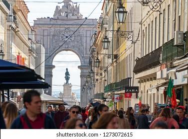 LISBON, PORTUGAL - NOVEMBER 1, 2018: people walking along Rua Augusta in the historic Baixa district in Lisbon, Portugal.