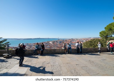 LISBON, PORTUGAL - NOVEMBER 14, 2017: Balcony with tourists in Lisbon castle (Castelo de Sao Jorge)