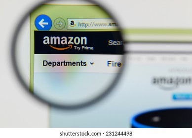 LISBON, PORTUGAL - NOVEMBER 17, 2014: Photo of Amazon homepage on a monitor screen through a magnifying glass.