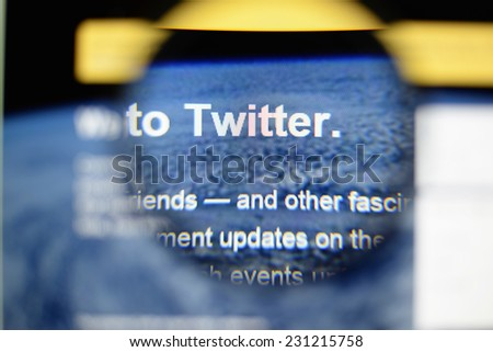 LISBON, PORTUGAL - NOVEMBER 17, 2014: Photo of Twitter homepage on a monitor screen through a magnifying glass.