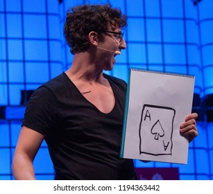 LISBON, PORTUGAL - NOVEMBER 2017: Julius Dein performs magic onstage at the Web Summit, Lisbon.