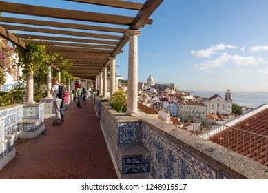 LISBON, PORTUGAL - NOVEMBER 21, 2018: Alfama, with the churches of S. Vicente de Fora, S. Engrácia, and S. Estêvão, and the Tagus river behind.