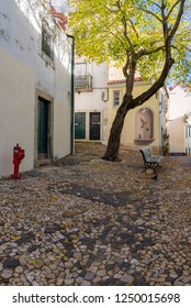 LISBON, PORTUGAL - NOVEMBER 21, 2018: A typical Alfama street