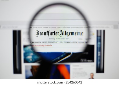LISBON, PORTUGAL - NOVEMBER 30, 2014: Photo of the Frankfurter Allgemeine Zeitung homepage on a monitor screen through a magnifying glass.
