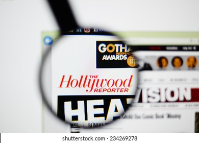 LISBON, PORTUGAL - NOVEMBER 30, 2014: Photo of The Hollywood Reporter homepage on a monitor screen through a magnifying glass.