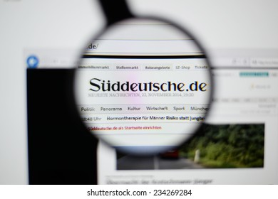 LISBON, PORTUGAL - NOVEMBER 30, 2014: Photo of Suddeutsche Zeitung homepage on a monitor screen through a magnifying glass.