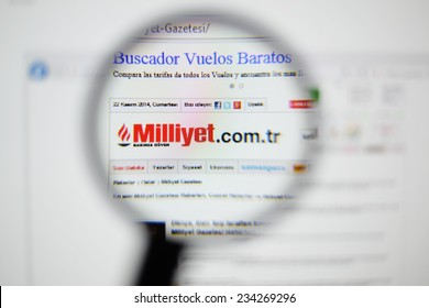 LISBON, PORTUGAL - NOVEMBER 30, 2014: Photo of Milliyet homepage on a monitor screen through a magnifying glass.