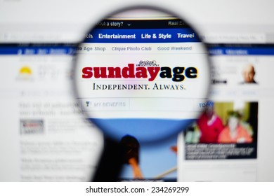 LISBON, PORTUGAL - NOVEMBER 30, 2014: Photo of The Sunday Age homepage on a monitor screen through a magnifying glass.