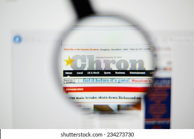 LISBON, PORTUGAL - NOVEMBER 30, 2014: Photo of Houston Chronicle homepage on a monitor screen through a magnifying glass.