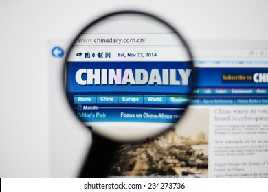LISBON, PORTUGAL - NOVEMBER 30, 2014: Photo of China Daily homepage on a monitor screen through a magnifying glass.