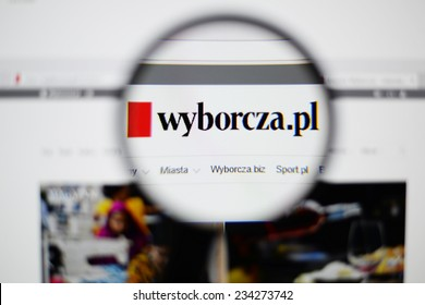 LISBON, PORTUGAL - NOVEMBER 30, 2014: Photo of Gazeta Wyborcza homepage on a monitor screen through a magnifying glass.