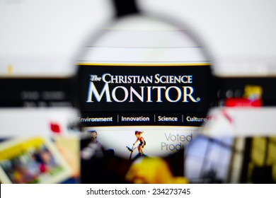 LISBON, PORTUGAL - NOVEMBER 30, 2014: Photo of the Christian Science Monitor homepage on a monitor screen through a magnifying glass.
