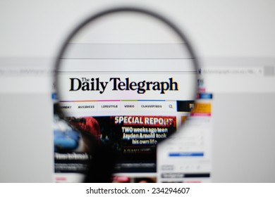 LISBON, PORTUGAL - NOVEMBER 30, 2014: Photo of The Daily Telegraph homepage on a monitor screen through a magnifying glass.